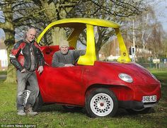 Big kids: John Bitmead, pictured with his brother Geoff, spent four months creating this life-size version of the classic child's Cozy Coupe