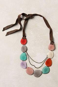 @anthropologie: chimborazo necklace...slices are tagua net slices dyed