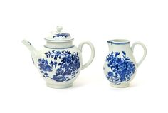 lot 340 A Worcester blue and white teapot and cover c.1770-75, and a large milk jug, both printed with the Fence pattern, a zig-zag ornamental fence amidst flowering peony branches, hatched crescent marks, a small body crack to the teapot, 16.8cm max. (3)  Provenance: the Professor Richard Clarke Coll
