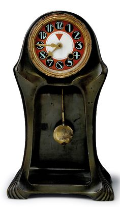 """ORIVIT Secessionist table clock, circa 1904. Pewter, clockface with polychromatic enamel, brass hands. Marked: """"ORIVIT"""", 2432. Measures H. 34.5 cm; 20 x 11 cm.  