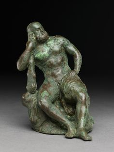 cast bronze figure of the hero god Heracles with his club seated on a lion.  Hellenistic kingdoms of Bactria or Gandhara in C. Asia or India 100 BCE-100 AD