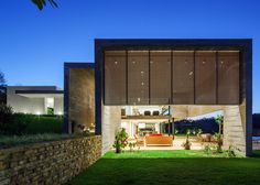 """This concrete residence by RMAA is split into a """"night floor"""" and """"daytime floor"""""""