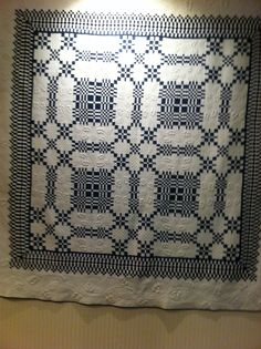 blue and white quilt in IQA office, posted by Sue Garman on her blog