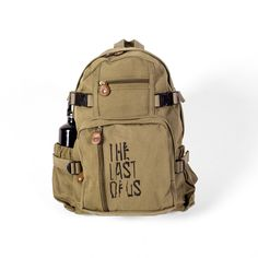 """Olive Vintage Canvas Mini Backpack with front screenprint Dimensions 15"""" x 13.5"""" x 7"""""""