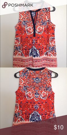 Fleur Bleue Red/Navy Scarf Print Sleeveless Blouse Bright red/navy scarf print woven sleeveless blouse by Fleur Bleue, from TJ Maxx. Red is bright, almost red-orange in color, neck is framed in navy. Great wear-to-work piece, fabric is not sheer, in perfect condition! Fleur Bleue Tops Blouses