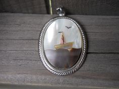 Items similar to Vintage Mother of Pearl Inlay Sailboat Pendant on Etsy Sailboat, Pocket Watch, Gemstone Rings, Pearls, Pendant, Trending Outfits, Unique Jewelry, Handmade Gifts, Accessories