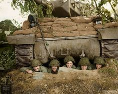 A US tank crew posing for the camera from a foxhole beneath their tank destroyer, north of Marigny, Normandy, 26 July The men belong to the Tank Destroyer Battalion attached to Combat Command B of the Armored Division. M10 Wolverine, M10 Tank Destroyer, History Online, Pose For The Camera, Ww2 Tanks, D Day, Military History, Us Army, World War Two