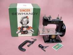 Singer Model 20 -10 Black Sewing Machine w/ Original Box   This Singer Model 20-10 Sewing Machine is in like new unused condition.  It has its clamp.  It is the model that only fits in its box when the wooden knob is removed.  That is here as well.  It even has a package of the hard to find toy needles.  None Nicer!!     Good + . . . . . . .sold for  195.00