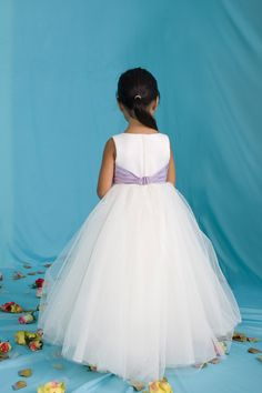 STYLE: 12283  Matte Satin and Tulle ball gown featuring a sleeveless bodice and modified taffeta bow at the waistline. The full gathered floor-length skirt is accented around the waistline by scattered sequins. A small train finishes the look. Available in all tulle colors in combination w/any satin or taffeta colors.