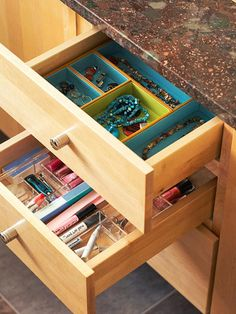 BRYCE: Break It Down - Capitalize on the space inside vanity drawers with office-supply dividers. Jewelry stays untangled inside fabric-lined compartments, and there's no more digging for your mascara when makeup is separated in clear plastic boxes. Dividers also make it easy to transport your entire stash to another mirror if the bathroom's busy.