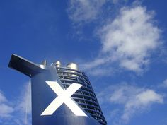 """Celebrity's trademark """"X"""" was added to one of the ship's smokestacks at the last minute. It looks awful in person :(Celebrity Solstice is the first of five in the Solstice Class of vessels deployed by Celebrity Cruises on behalf of Royal Caribbean International. Other vessels in the Solstice class include the Celebrity Equinox and the Celebrity Eclipse."""