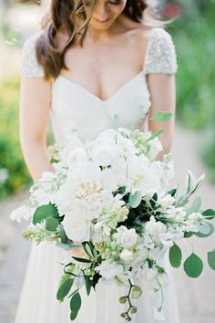 White peonies with white roses, ranunculus and eucalyptus: http://www.stylemepretty.com/2015/06/10/the-25-prettiest-peony-bouquets/