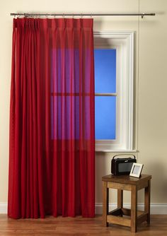 Luxury Linen look cherry voile curtain with pinch pleat heading, a lead weighted hem and also Fire Retardant.