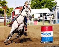 My new horse Cash & me tearin it up at a barrel race