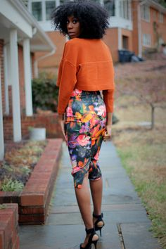 Floral skirt and orange jacket