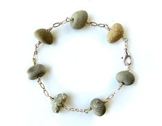 This grounding natural stone bracelet is a beautiful way to bring the spiritual harmony of pounding waves and wide open spaces into your indoor human ecosystem.  The perfect geology gift for a woman who believes more in rocks and streams and mountains than in diamond mines and factories and department store jewelry counters!