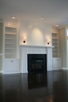 Custom fireplace and built-in bookcase by www.PrestigeHomesOhio.com
