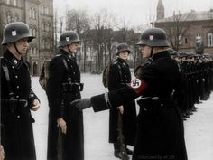 SS Guardsmen under inspection by an officer during a cold winter afternoon.