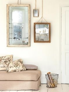 cool way to hang mirrors without putting holes in the wall...