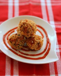 Spinach and Cheese Meatballs: Coated in crispy panko breadcrumbs, these spinach and cheese sausage meatballs are sure to please! Easy to make, bake to perfection and enjoy! #Recipes #Recipe #Appetizers #Snacks #Sausage #Meatballs #Cheese #Baked #Spinach