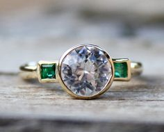 allaboutrings: White Sapphire and Emerald 3-Stone Engagement Ring in 14k Gold https://www.etsy.com/listing/125331845/white-sapphire-and-em...