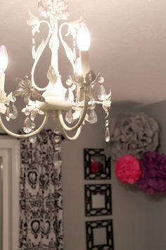 This elegant nursery has a sophisticated chandelier.