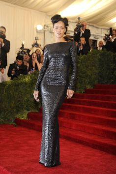 Rihanna wears a tight black Tom Ford dress on the red carpet of the MET Gala in NYC. See full gallery here: http://bit.ly/ISkhB2