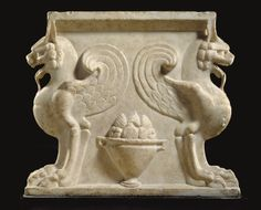 A ROMAN MARBLE TABLE SUPPORT -  CIRCA 1ST-2ND CENTURY A.D.