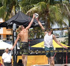 Stafford Slick, left, jousts with Brad Keenan during the 2011 Jose Cuervo Pro Beach Tour event in Miami
