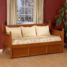 I like this craftsman style day bed, but I'd need lots and lots of big cool funky pillows to keep it from looking like a crib.