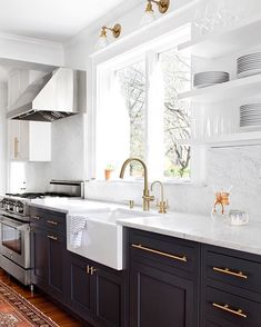 love love love! The color on the lower cabinets is Farrow and Ball - Downpipe which is a really deep gray. The faucet is Newport Brass (newportbrassfaucets.com). The hardware is from Lew's Hardware (www.lewisdolin.com). White cabinets is BM Decorators White.