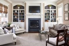 lovelyhomedesign.net wp-content uploads 2016 10 Arched-bookcases-living-room-traditional-image-ideas-with-framed-artwork-white-window-shutters-gray-carpet-3.jpg