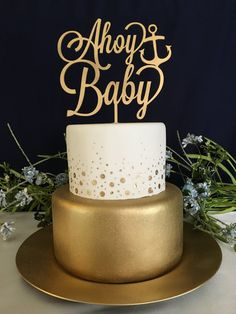 "www.psweddingsandevents.com  This listing is for 1 ""Ahoy Baby"" cake topper made of 1/8"" thick, recycled eucalyptus board. The cake toppers wording is approximately 7"" wide and 6"" tall. The stick to go into your cake is approximately 5"" tall. This cake topper is available in: gold,"