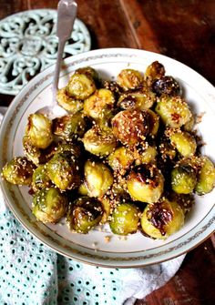 Garlic & Sesame Brussel Sprouts. Crisp roasted brussel sprouts covered in toasted sesame seeds and garlic. Gluten free, dairy free, vegan and paleo.