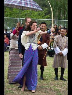 Catherine tests  her Archery skills in Bhutan. Her arrow missed the target but she just laughed - Day 5