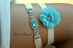 Select if you want the keepsake garter, toss garter, or both! Keepsake garter is made with a stunning rhinestone embellishment with with a turquoise center stone. These are perfect for that something blue. Garter elastic has a silicone backing, so it wont slip. Rhinestone embellishment part is approximately 3 x 3/4.  Toss garter is made with a single chiffon flower embellished with rhinestones and beads.  Garters make a wonder keepsake for that special day!  ~~~~~~~~~~~~~~~  ELASTIC COLOR…