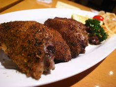 Tebasaki - chicken wings that are deep fried without batter until crispy and seasoned with a spicy-sweet sauce.