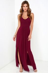 If you're looking for a number that will never lose its elegance and fashion appeal, you've come to the right place! The Bariano Test of Time Burgundy Maxi Dress has a gently sloping neckline (with no-slip strips) topped by dainty chiffon spaghetti straps in a rich burgundy hue. The chiffon continues into a bodice with lightly padded cups, hidden boning, plus diagonal and vertical pleats that transition from the fitted waist into a sweeping maxi skirt with two side slits. Hidden back zipper…