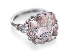 NATURAL DIAMOND 8 CT PINK MORGANITE & DIAMOND RING.    Absolutely beautiful custom 18k white gold morganite & diamond ring by Jordan Collection. This stunning ring features a 7 carat cushion cut morganite & an exquisite 3 wire band set with diamond leafs.