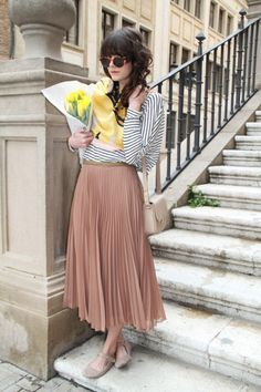 Black and white striped shirt with a nude pink pleated skirt, plus some yellow flowers to brighten up the photo. :]