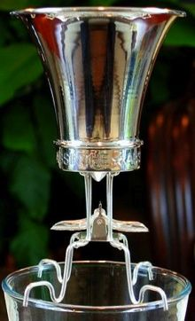 """Absinthe Drippers/Brouilleurs. """"You first pour some Absinthe in the Absinthe glass. Then you place the brouille on top. Now a sugar cube has to be put on the first level grill. Then you fill the second level cup with ice and water. Now sit back, relax and watch the """"Absinthe machine"""" work."""""""
