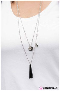 """A large translucent black bead hangs in the center of a long, layered silver chain and is adorned with silver accents. Accents include two wavy silver discs, a centered silver disc with """"First Love"""" inscribed into its finish and a small texturized ring. Features an adjustable clasp closure.  Sold as one individual necklace. Includes one pair of matching earrings."""