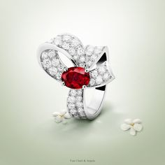 The Van Cleef & Arpels Boucle solitaire evokes passion and love - platinum, diamonds, one oval-cut ruby central stone of 1,45 carats - #VCAbridal #EnchantingLoveStories Find out more about rubies by Van Cleef & Arpels.