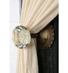 Glass door knobs for drapes pullback..Yrs I have many and many ideas!  But I like this one a lot