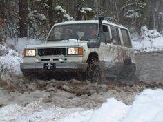 Isuzu trooper mudding it in the snow!  Offroad
