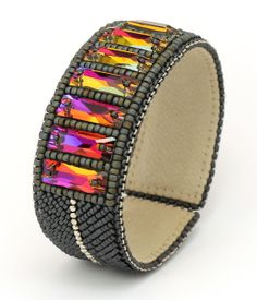 Beaded cuff bracelet with rectangular Swarovski crystals, Japanese seed beads, metal beads, leather on the inside, inside the metal base by Natasha Shcherbakova