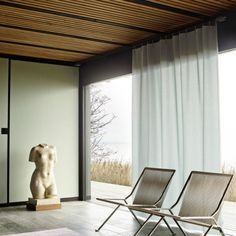 Timber ceilings; sculpture; curtains & chairs