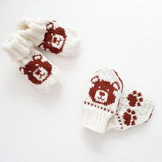 Knitting patterns on Ravelry for baby socks and baby mittens featuring a teddy bear on the front and paw prints on the back Baby Mittens, Knit Mittens, Baby Socks, Knitting Bear, Knitted Animals, Mittens Pattern, Paw Prints, Knitting Accessories, Kids And Parenting