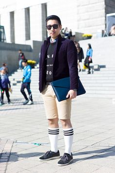 A bold and sporty styling variation of the preppy look outside Seoul Fashion Week 2012.