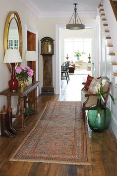 Southern Living Idea House in Charlottesville, VA Bunny's musts for a stylish entryway? A patterned runner, dramatic table lamps, a large mirror, and a narrow console. Foyer Decorating, Interior Decorating, Interior Design, Decorating Ideas, Room Interior, Interior Ideas, Decor Ideas, Traditional Decor, Traditional House